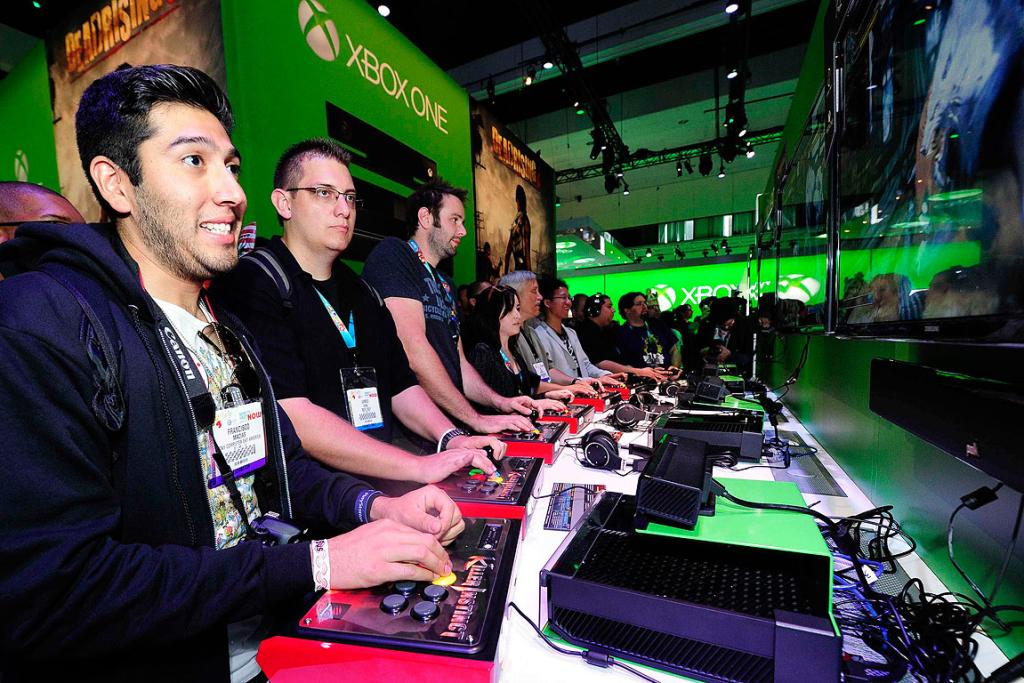 Gamers try out the new Xbox One with a third party controller during E3.