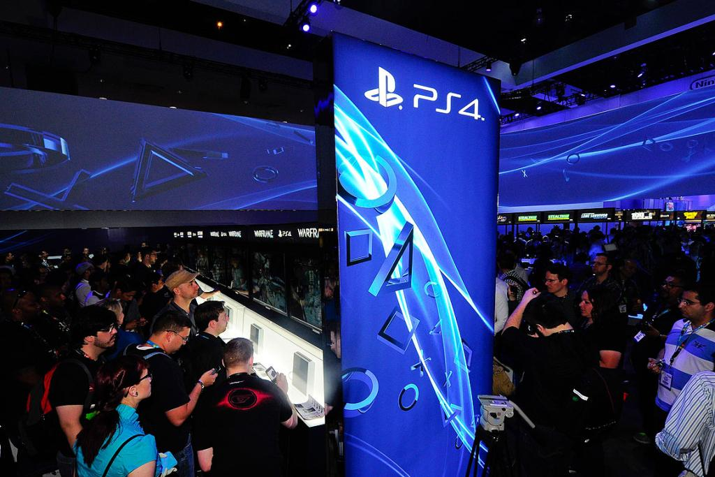 Gamers try out the new Sony PlayStation 4 during E3 in Los Angeles, California.