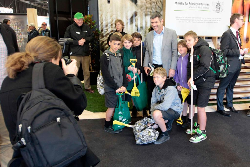 Minister of Primary Industries Nathan Guy gets his photo taken with students from Mt Maunganui Intermediate.