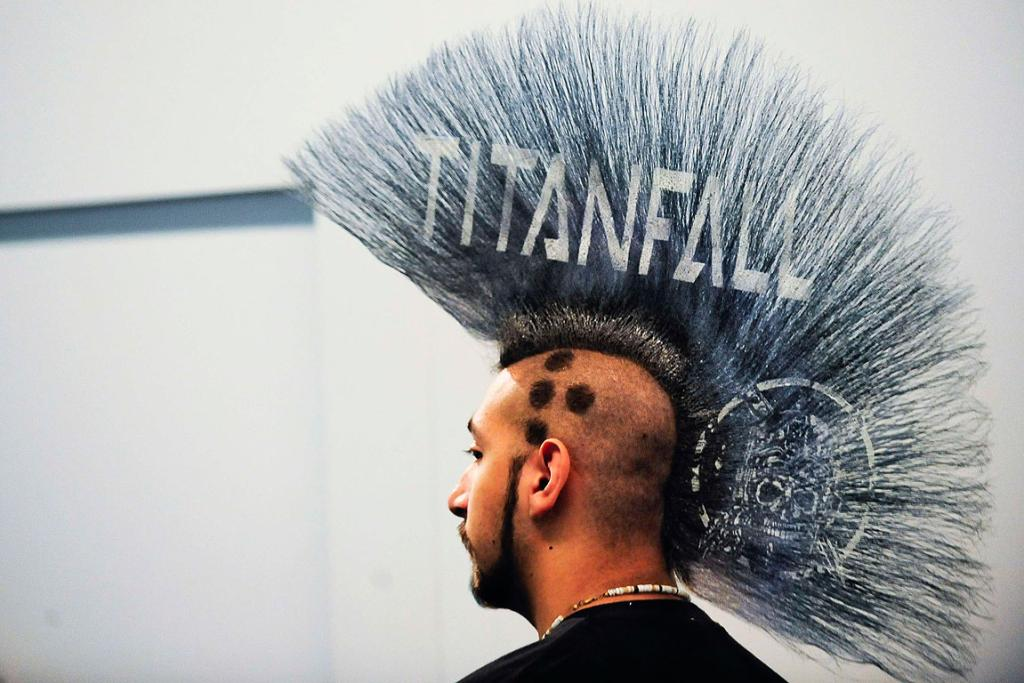 The new Electronic Arts game Titanfall's logo ion the mohawk of a man at E3.