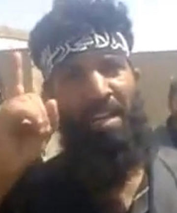 A Sunni militant boasts of killing Shi'ites in the Syrian village of Hatla in a video posted on YouTube on June 11.
