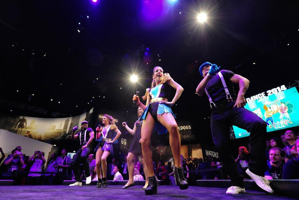 """Dancers perform at the """"Just Dance 2014"""" booth."""