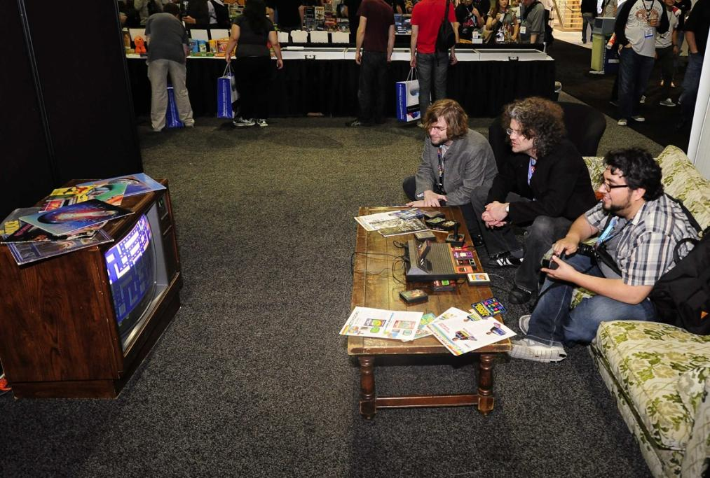Gamers play Pac Man on an Atari game console.