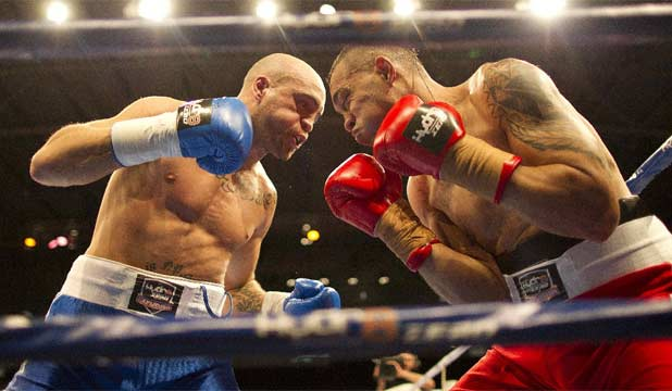 SAM THE MAN: New Plymouth's Sam Rapira moves in to finish off Tongan Viliami Taofi in the first round of their pro light heavyweight boxing bout in Auckland.