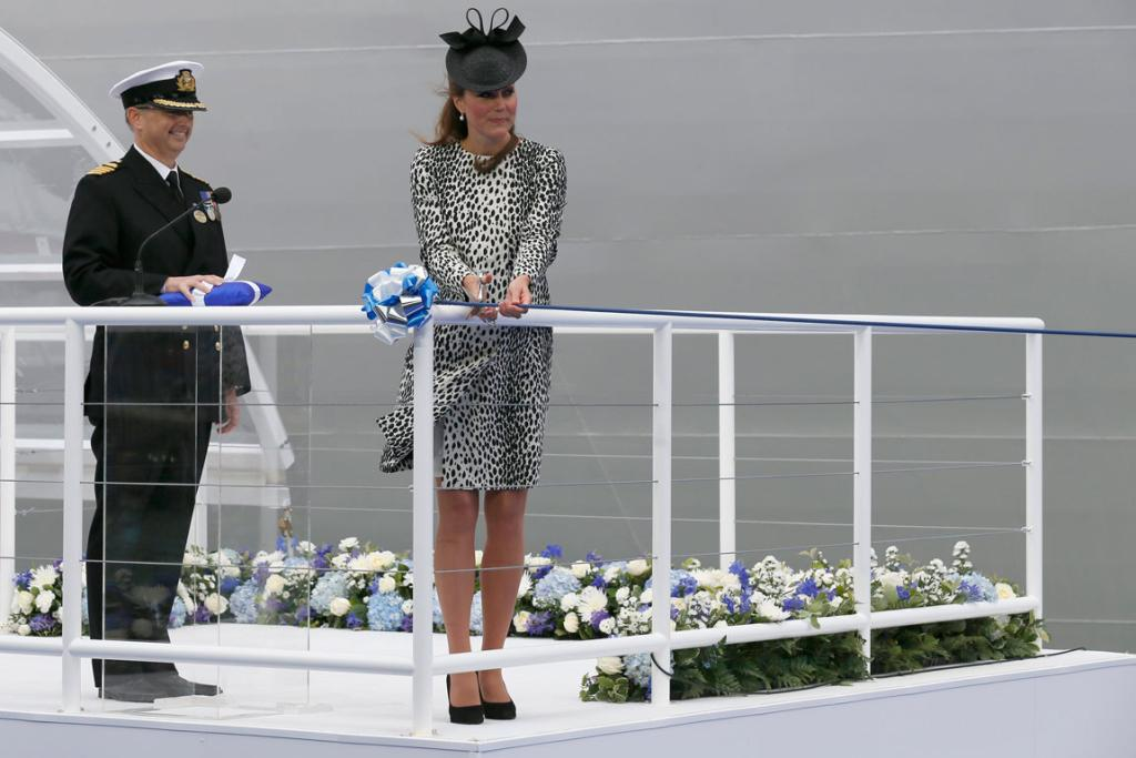 Britain's Catherine, Duchess of Cambridge, cuts a ribbon to release a bottle of champagne during the naming ceremony of the 'Royal Princess' cruise ship in Southampton, southern England.