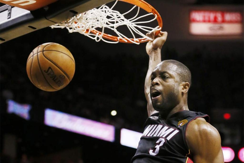 Miami Heat's Dwyane Wade dunks against the San Antonio Spurs during Game 4.