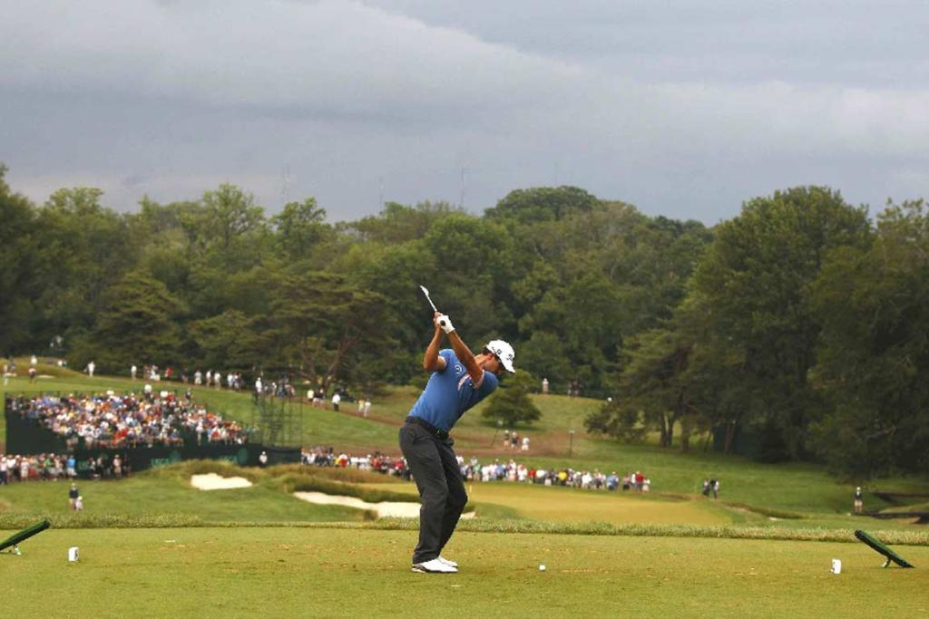 Masters champion Adam Scott tees off on the ninth hole at Merion.