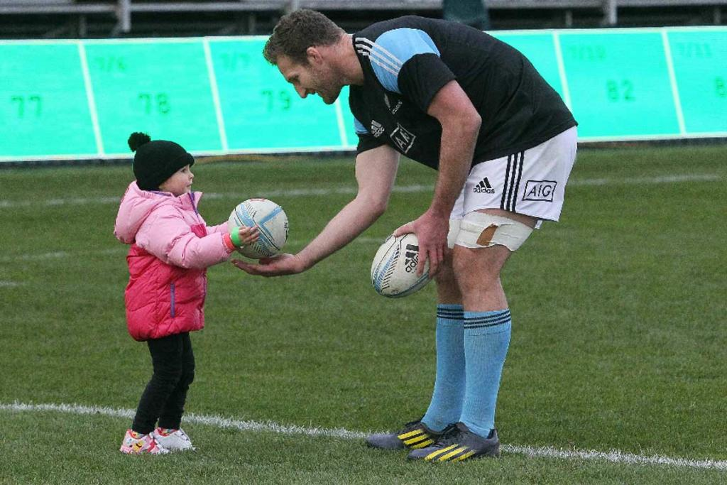 All Blacks captain Kieran Read plays with daughter Elle during the captain's run at AMI Stadium.