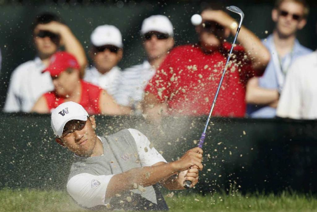 Taiwan's Cheng-Tsung Pan plays from the bunker at the 15th hole.