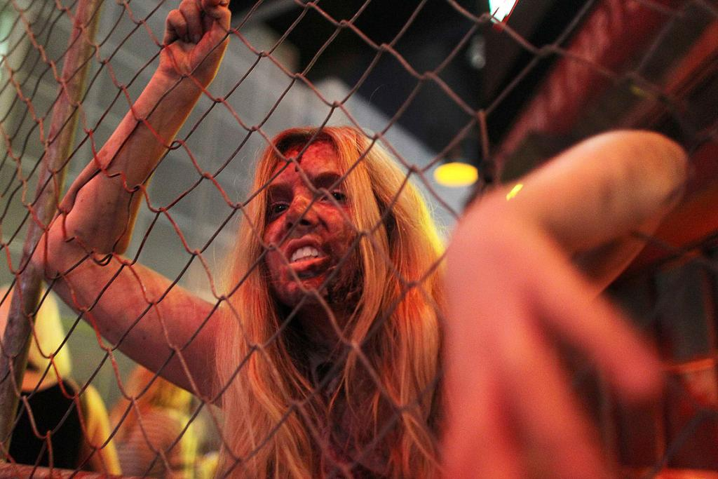 A zombie 'booth babe' at the Konami exhibit for the game Dead Rising 3 at E3.