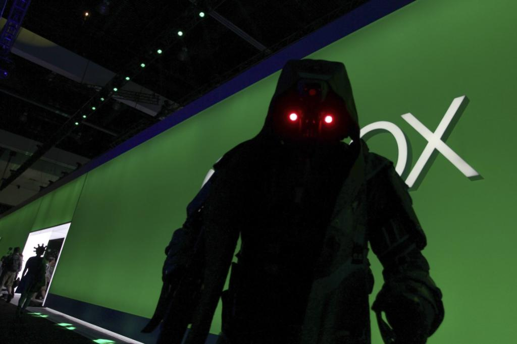 A character from Killzone: Shadow Fall walks through an exhibit hall.