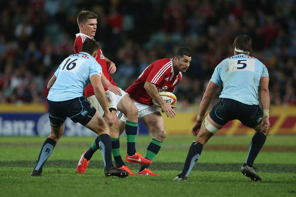 Rob Kearney of the Lions breaks with the ball during the match between the NSW Waratahs and the British & Irish Lions.