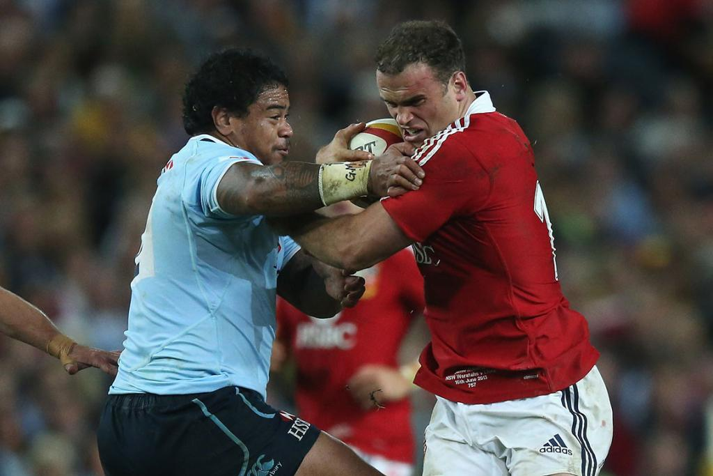 Jamie Roberts of the Lions is tackled by John Ulugia during the match between the NSW Waratahs and the British & Irish Lions.