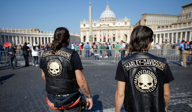 Harley-Davidson bikers walk outside Saint Peter's Square to attend a mass to be led by Pope Francis in Rome.