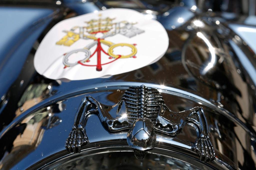 The Vatican's coat of arms is stuck on a Harley Davidson.