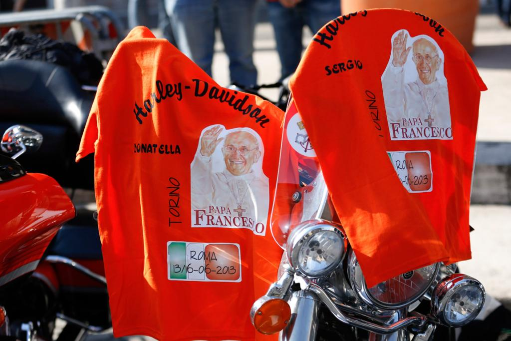 T-shirts with pictures of Pope Francis are hung over the bikes.