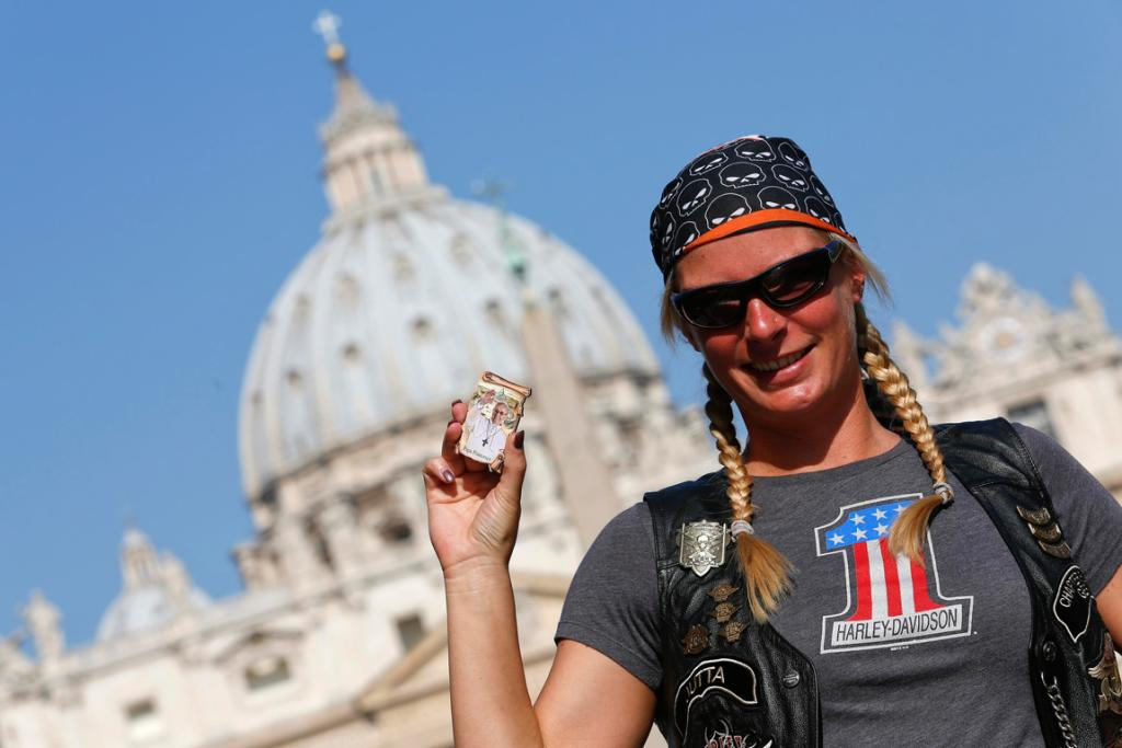 A Harley Davidson biker from Germany holds a souvenir of the pope.