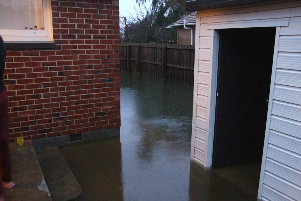 Flooding outside Rummy Strong's flat in Mairehau, Christchurch
