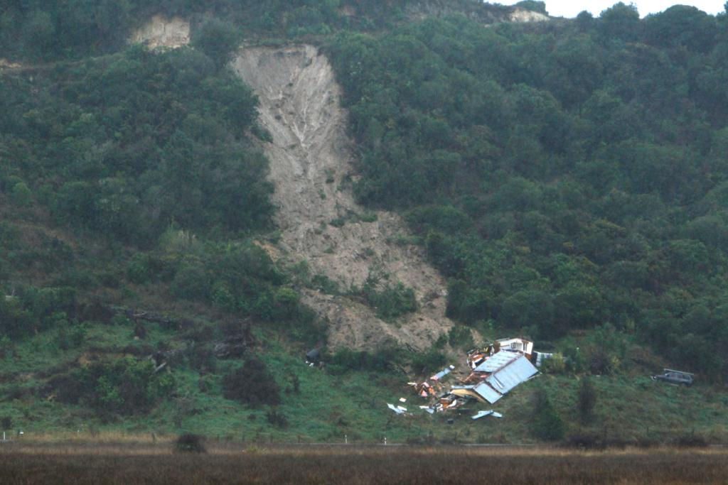 A woman was killed when this massive slip hit her house in Sandy Bay.