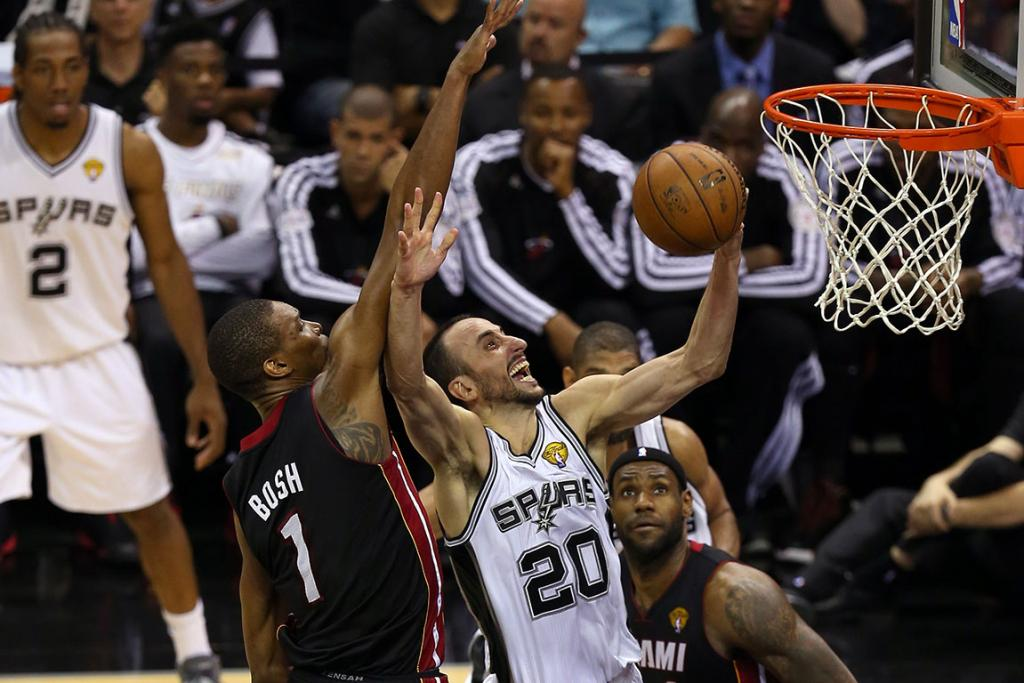 Manu Ginobli of the Spurs goes for a lay-up on his way to 24 points.