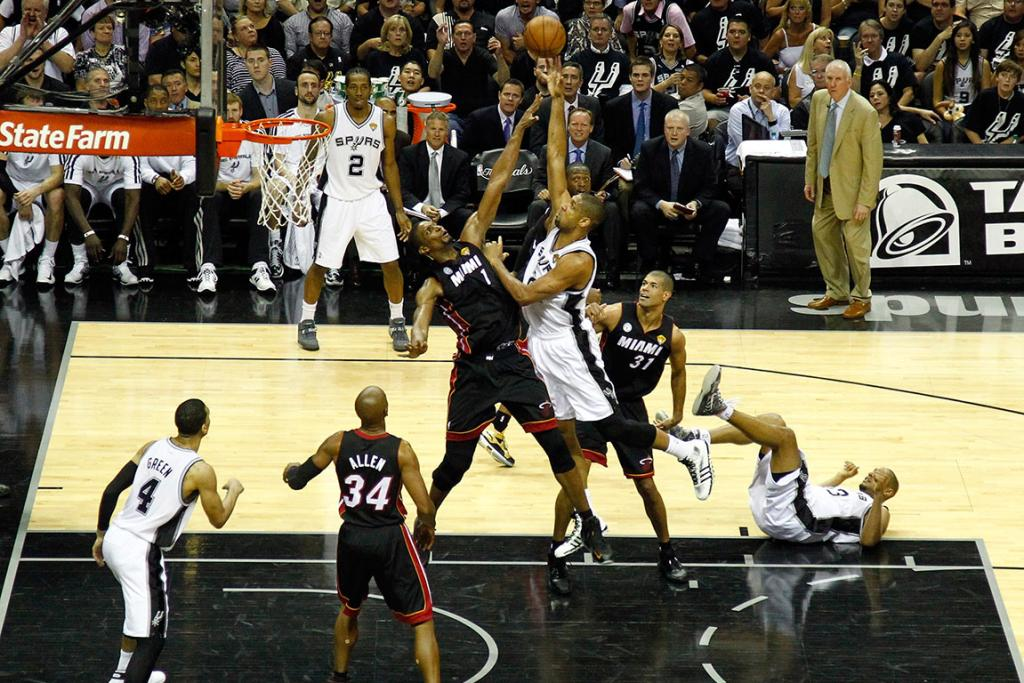 Tim Duncan goes high over Chris Bosh in Game 5.
