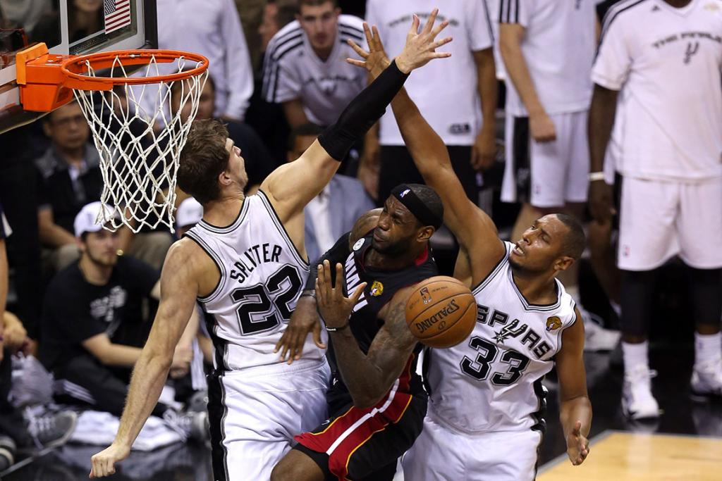 LeBron James can't get through the Spurs defence as he attempts a lay-up in the Heat's Game 5 loss.