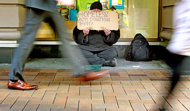 SIGN OF THE TIMES: A homeless man begging in Lambton Quay. The 'alternative giving' campaign is set to begin on July 1.