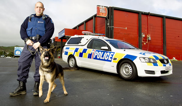 CANINE COP: Police dog handler Stu Rota with Link at Waitangirua Mall.