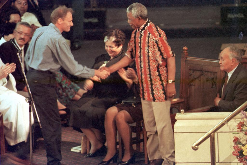President Nelson Mandela shakes the hand of John Minto when he  met the 1981 springbok protesters and thanked them for their efforts at St Mathews in the City during CHOGUM conference.