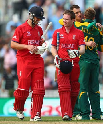 JOB DONE: England's Eion Morgan (left) and Jonathan Trott walk from the pitch after guiding the hosts to a seven-wicket victory over South Africa in the first Champions Trophy semifinal at The Oval.