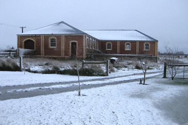 Homebush's Woolshed, covered in snow and frost.