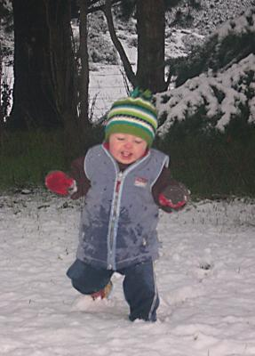 FIRST SNOW: Kylee Simpson snapped this photo of her son Riley, 14 months, playing in his first snow at Lake Coleridge today.