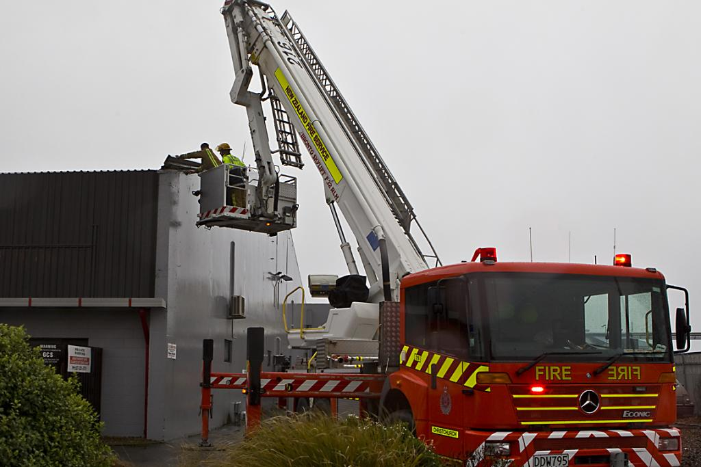 HAMMERED DOWN: Wind lifted part of the roof at the Howzat Indoor Sports Centre today.