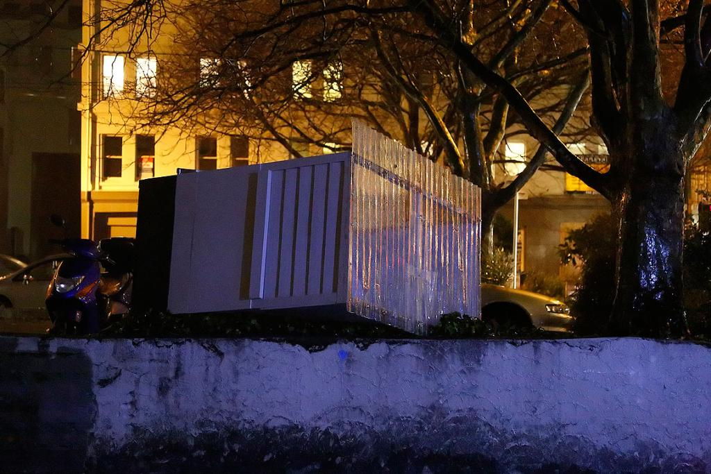 An overturned parking ticket machine shelter on Victoria St in central Wellington.