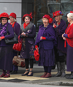 The Red Rascals group of Rangiora in full voice on an outing in Papanui. The Red Hat Society is a worldwide organisation.