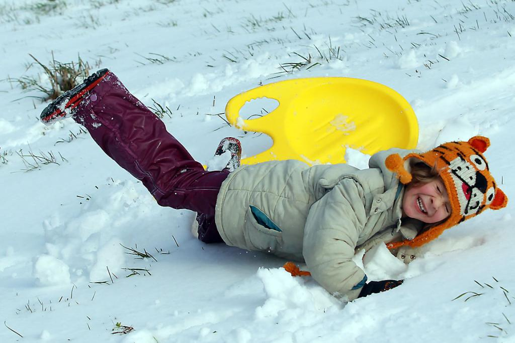 SNOW DELIGHTS: Eli Hansen, 5, makes the most of a day off school to play at Victoria Park, Cashmere.