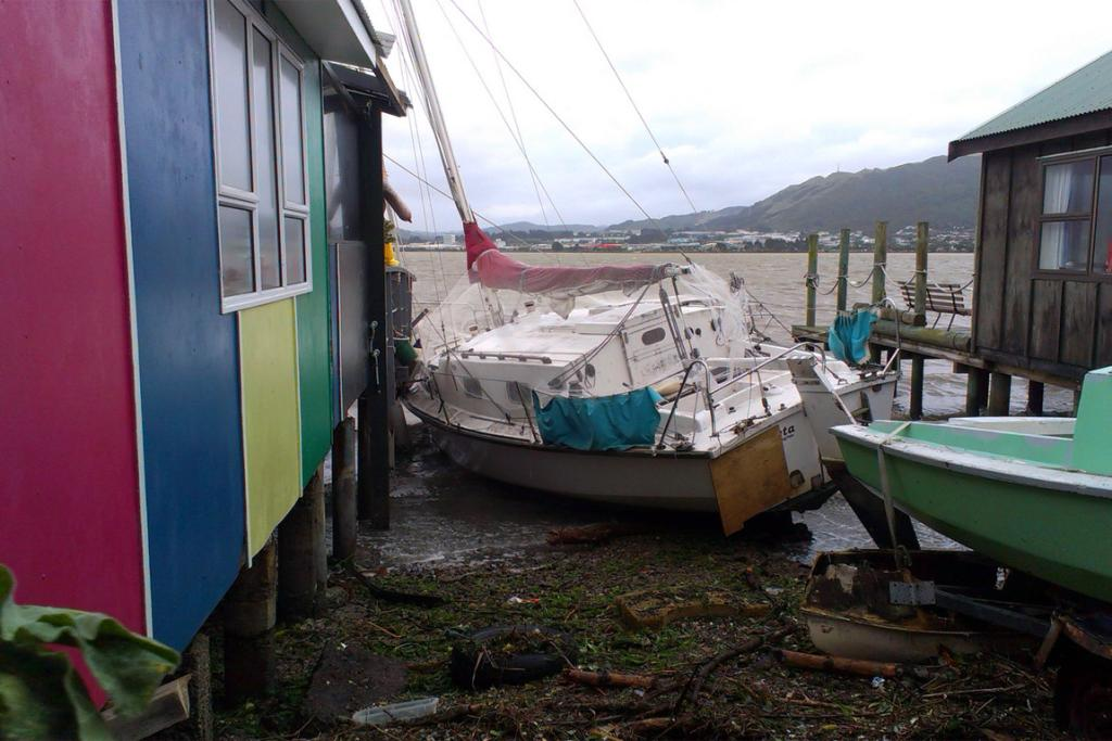 A boat from Porirua Harbour strikes boat sheds.