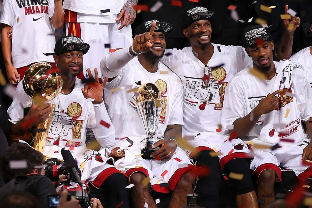 From left: Dwyane Wade, LeBron James, Chris Bosh and Norris Cole of the Miami Heat celebrate their title win.