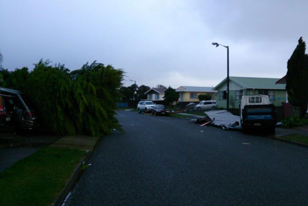 Roofs and trees litter the streets of Kelson, Lower Hutt.