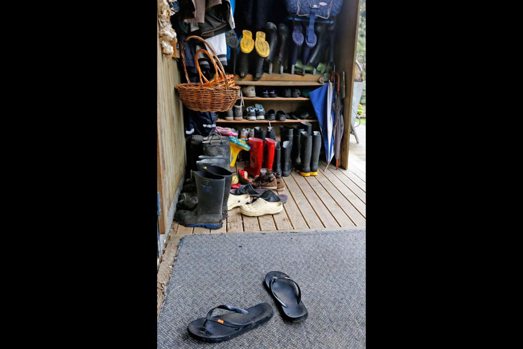 The Bishop's jandals, along with other shoes, outside the dinning room and kitchen.