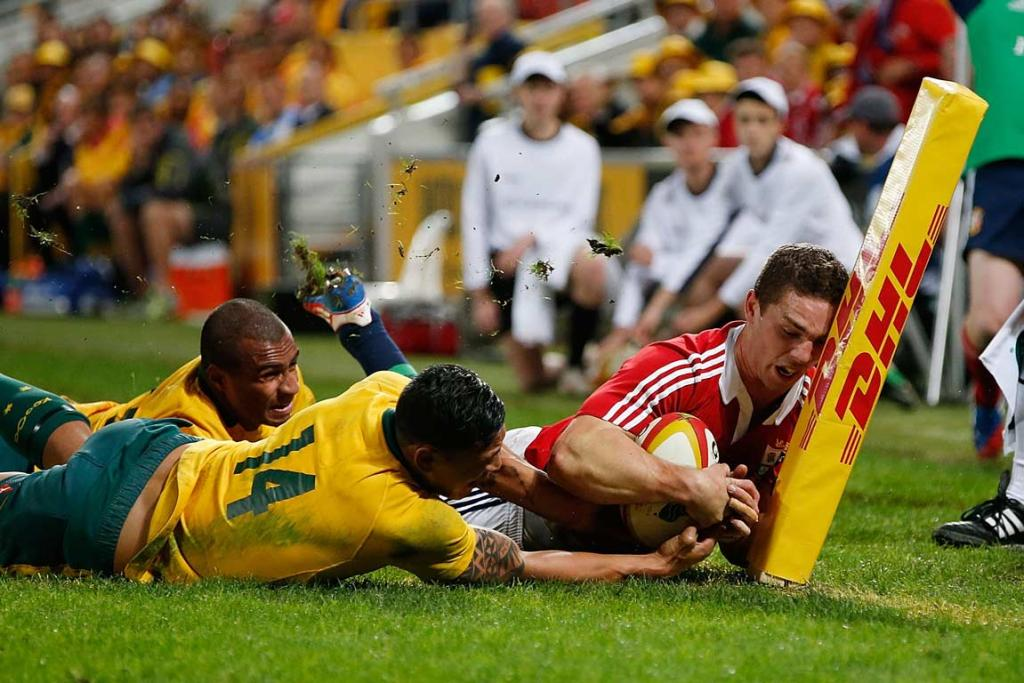 Israel Folau denies George North a try in the corner.