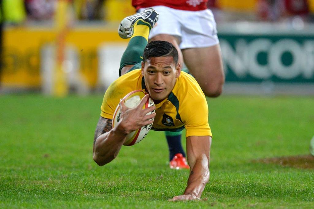 Israel Folau dives over to score one of his two tries in the first half.