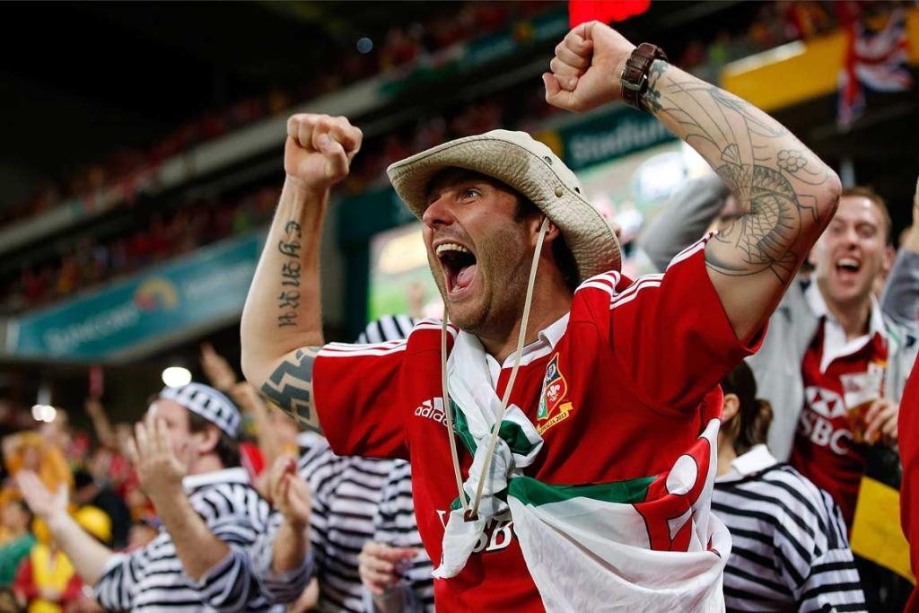 A fired-up Lions fan celebrates the first test victory.
