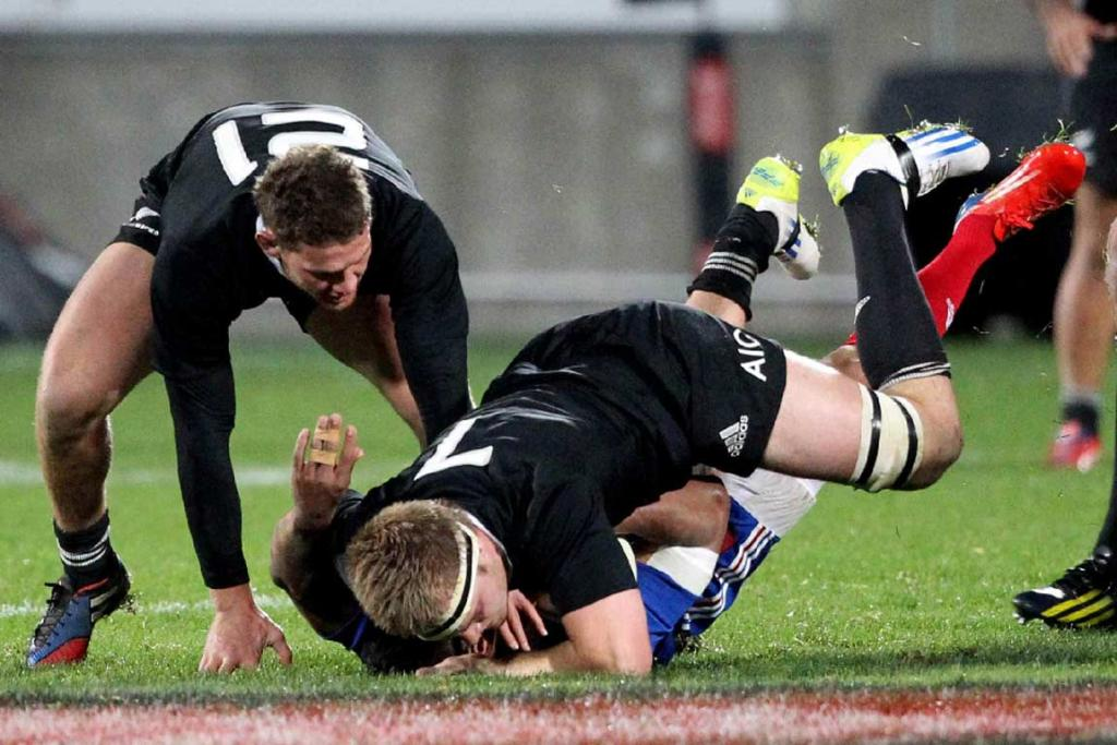 Sam Cane monsters a French player in a big tackle.