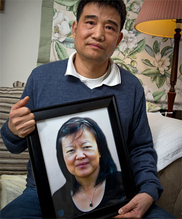 Jack Liu, the partner of missing North Shore accountant Cissy Chen, with a photo of his wife