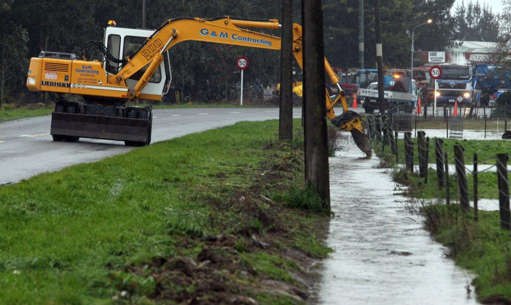 A digger was working to keep the drain along Station Street clear.