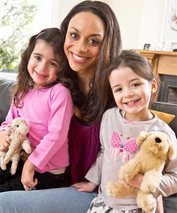 Sonia Gray with 4-year-old  twin daughters Inez and Thandie.