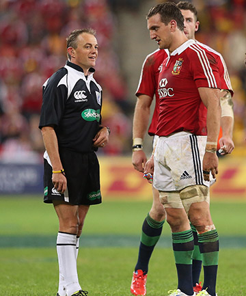 CONTROL: Referee Chris Pollock speaks with Lions captain Sam Warburton during the first test.