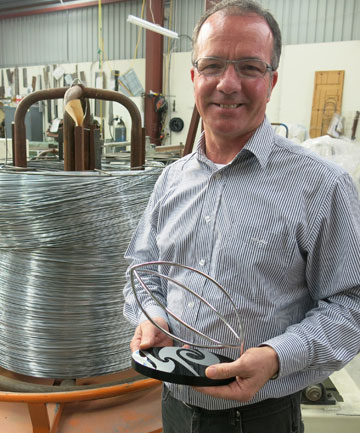 UP WITH THE PLAY: Wire Displays owner Mark Corrigan is moving from hands-on to computerised wire production to compete with the Chinese import market.