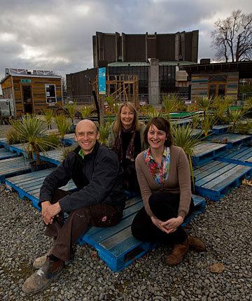 WATCH THIS SPACE:  Trent Hiles, left, and Coralie Winn, front,  of Gap Filler, and Jane Gregg of Life in Vacant Spaces, back, at the Pallet Pavilion on the old Crowne Plaza Hotel site.